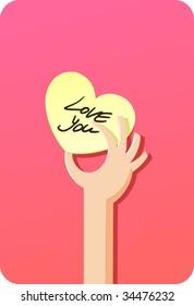 Valentine card (heart shape card) and human hand.