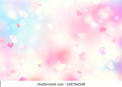 Valentine day blurred hearts light background.Romantic soft backdrop.