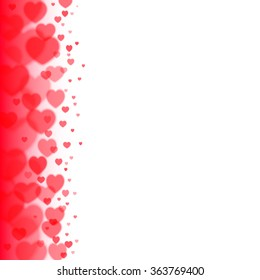 Valentines Day background with scattered blurred hearts on the left