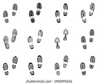 Various black prints of shoes on a white background