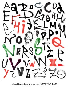 Vector alphabet. Hand drawn letters. Letters painted using spray can. Spots and blotches.