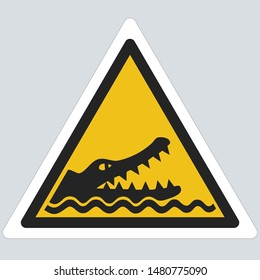 Vector Yellow Dangerous triangle crocodile sign icon. Warning Sign yellow triangle crocodile sign. Illustration of a crocodile symbol sign in flat minimalism style.
