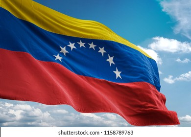 Venezuela national flag waving in the blue sky realistic 3d illustration
