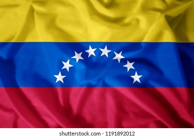 Venezuela stylish waving and closeup flag illustration. Perfect for background or texture purposes.