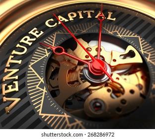 Venture Capital  on Black-Golden Watch Face with Watch Mechanism. Full Frame Closeup.