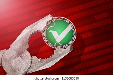 Vertcoin (VTC) coin is under pressure. Concept of the regulation or control of vertcoin (VTC) cryptocurrency; limitation; prohibition