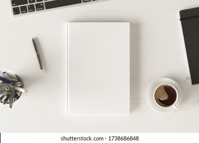 Vertical book cover mock up. Workspace on white wooden desk with cup of coffee. View directly above. 3d render.