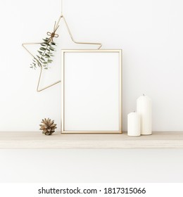 Vertical frame mockup with gold matal star, eucalyptus twigs, pine cones and candles on empty white wall background. Minimalist Christmas interior decoration. A4, A3 format. 3d rendering, illustration