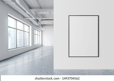 Vertical mock up poster frame hanging in modern industrial style office with white walls, concrete floor, windows with cityscape and pipes. Concept of advertising and art. 3d rendering