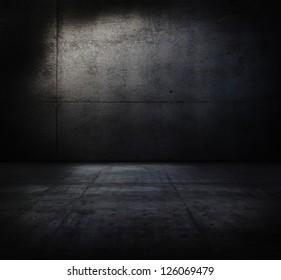 Very dark and dim concrete room.