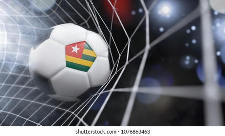 Very realistic rendering of a soccer ball with the flag of Togo in the net.(3D rendering)