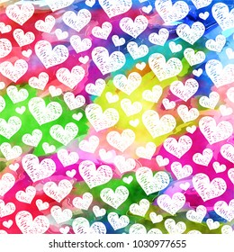 A vibrant and colorful digital watercolor ink love heart pattern.