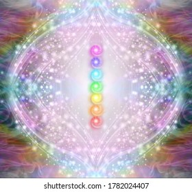 Vibrant Shimmering Seven Chakra Stack - a vertical row of seven rainbow coloured energy chakras against a circle of white and pink stars and sparkles