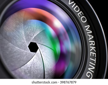Video Marketing - Concept on Front of Camera Lens with Colored Lens Reflection, Closeup. Video Marketing Written on a Front of Camera Lens. Closeup View, Selective Focus, Lens Flare Effect. 3D.