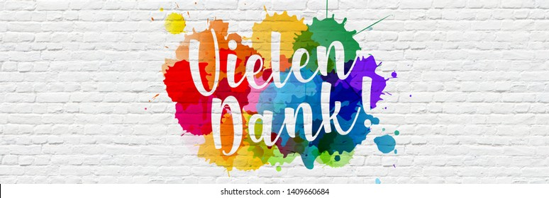 """"""" Vielen Dank """" : Many Thanks in german, with colored splashes on a brick wall"""