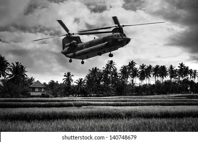 Vietnam War 'style' B&W image circa 1968 of a chinook helicopter about to deploy soldiers into the rice paddies of South Vietnam looking for Viet Cong during the Tet Offensive. (Artist's Impression)