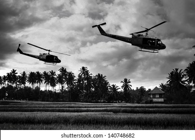 Vietnam War 'style' B&W image circa 1968 of two helicopters flying low over the rice paddies of South Vietnam looking for Viet Cong insurgents during the Tet Offensive in 1968. (Artist's Impression)