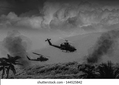 Vietnam War 'style' B&W image circa 1968 of two helicopter gunships flying low over the jungle of South Vietnam looking for Viet Cong and the North Vietnamese Army. (Artist's Impression)