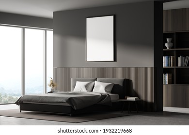 View of a bedroom with king size bed, a bookshelf, a panoramic window. Large vertical poster is hanging above the bed. 3d rendering. Mock up.