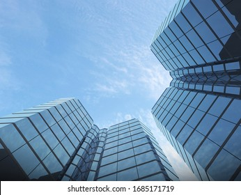 View of glass building on blue sky background,Business concept of future architecture,looking up to the light on the top of building. 3d rendering.
