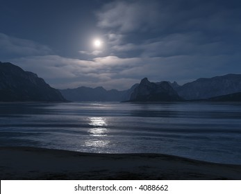 view from a nightly beach on the moonlit sea