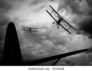 View from the open rear cockpit of enemy plane over the tail and rear wing. Two double wing biplane giving chase through storm and smoke filled clouds. Original Illustration