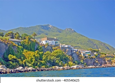 View of the steep coast of the island Ischia with the Monte Epomeo in the background. The island is situated in the gulf of naples in italy