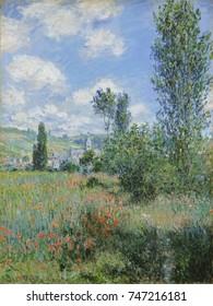View of Vetheuil, by Claude Monet, 1880, French impressionist painting, oil on canvas. A footpath starts at lower right and disappears into the poppy field. In distance is the church tower at Vetheuil