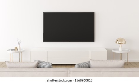 View of white living room in minimal style with television and gold lamp, Interior design with TV and cabinet on white wall, 3d rendering.