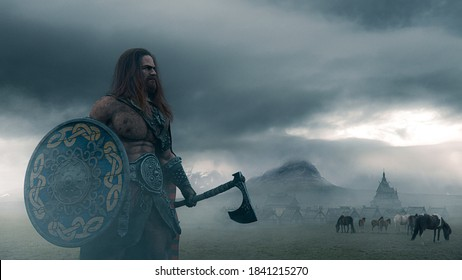 Viking warrior holding an ax and a shied on a foggy landscape with ancient village and horses in northern panorama - concept art - 3D Rendering