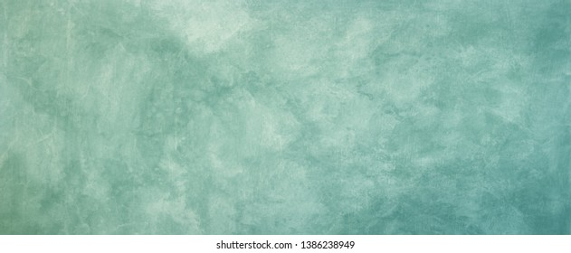 Vintage background texture. Old blue green marbled grunge textured design with faded distressed pattern in pastel antique backdrop.