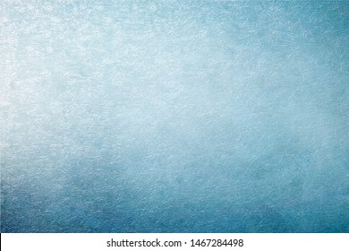 Vintage blue texture for background. Artistic plaster. Abstract pattern. Illuminated rough surface. Raster image.