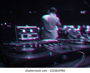 Vintage dj turn table player edited with 3d stereo effect.Retro anaglyph filter and old analog disc jockey turntables in night club on stage.Rap singer with microphone on background