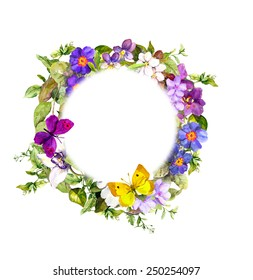 Vintage floral wreath - meadow flowers, wild grass and spring butterflies. Watercolor