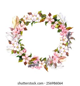 Vintage frame - wreath in boho style. Feathers and spring flowers (cherry, apple flower blossom). Watercolor