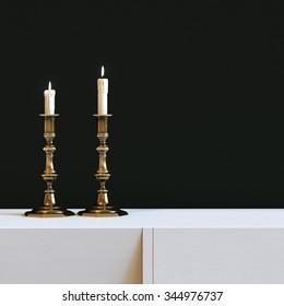 Vintage golden candlestick with burning candles in black interior. 3d render