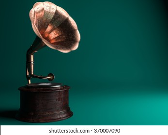 Vintage gramophone on green background