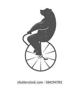 Vintage Illustration fun bear with grunge effect for posters and t-shirts. Funny bear on unicycle on a white background. Raster version.