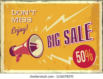 vintage megaphone. Big sale poster with grunge texture. Retro megaphone on the orange background with place for text.