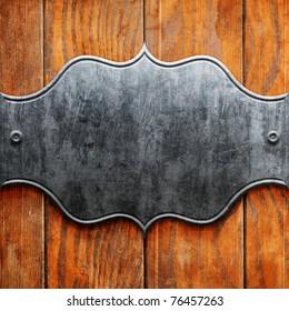 Vintage metal signboard on old wooden planks