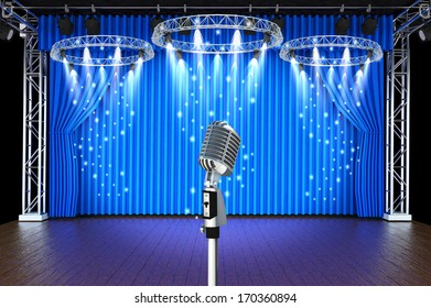 vintage microphone with spotlight in Theater stage with blue curtains background