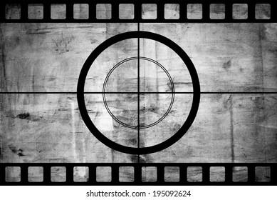 Vintage movie film strip with countdown border over grunge background