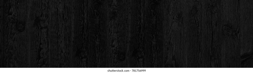 Vintage rustic black wood texture of old pine boards with knots. Cool wide black panoramic background with wood pattern. Earth Hour background.