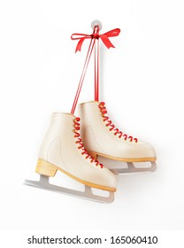 vintage skates hanging on the white wall, isolated on white background