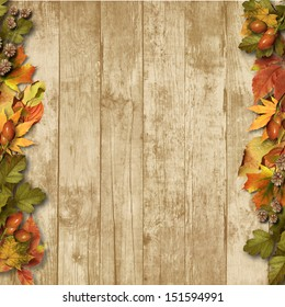 vintage wooden background with autumn leaves