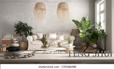 Vintage wooden table shelf with pebble balance and 3d letters making the word feng shui over old style living room in beige tones, sofa, pillows, plants, zen concept interior design
