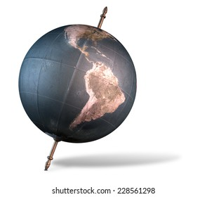A vintage world globe tilted and standing on a central axis on an isolated white background