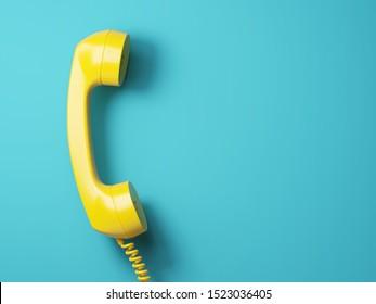 Vintage yellow telephone on a aquamarine background. 3d illustration