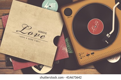 vinyl record and player on wooden background, vintage tone