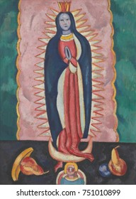 THE VIRGIN OF GUADALUPE, by Marsden Hartley, 1918-19, American painting, oil, charcoal on paperboard. The painting depicts a bulto, a small carved and painted religious statue. It was possibly inspire